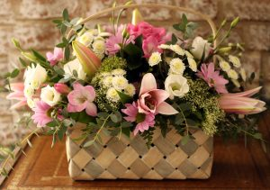 Charm someone with this delightful seasonal flower basket. A very traditional gift, filled with Pink Chrysanthemums, White Lisianthus, scented Freesias, White Trachelium with a Pink Aqua Rose in the centre complimented with seasonal foliage.