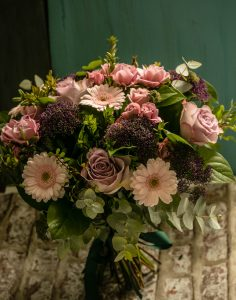 A beautifully created hand-tied combination of Spray Pink Roses, dusky Lilac Roses with mini pale Pink Gerberas with deep Purple Trachelium complimented with seasonal foliage. A lovely gift for any occasion, very feminine. Choosing this bouquet, you will make somebody very happy.